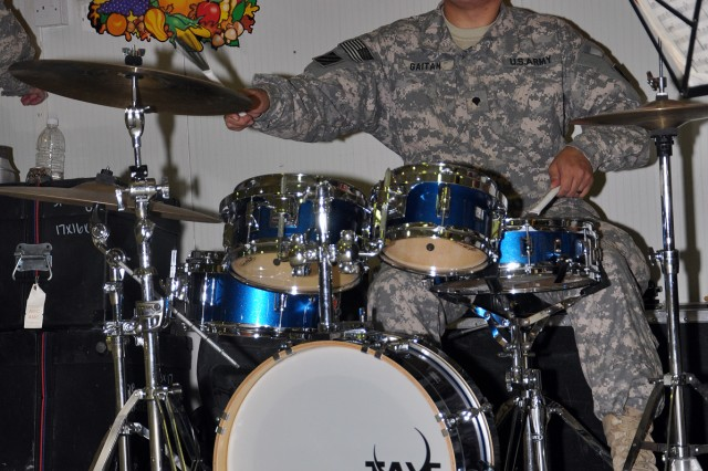 Spc. Eisner Gaitain, 3rd Infantry Division bandsmen, plays Christmas music on his drums with the 3rd Infantry Division's The Marne Jazz Ensemble in the dining facility here Nov. 26 as part of the Thanksgiving festivities. (U.S. Army photo by Sgt. Matthew C. Cooley, 15th Sustainment Brigade public affairs)