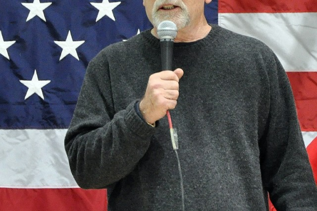 Retired Marine Lt. Col. Bill Cowan, a Fox news analyst and Sacramento, Calif., native, tells jokes and praises U.S. Service Members before introducing Country music singer Aaron Tippin at a concert for the troops at the Morale Welfare and Recreation tent here, Nov. 27. (U.S. Army photo by Sgt. Matthew C. Cooley, 15th Sustainment Brigade public affairs)