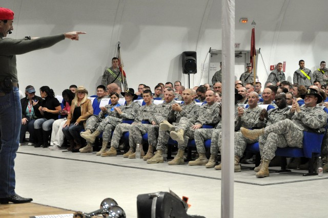 Country music singer and Pensacola, Fla., native, Aaron Tippin performs for the troops at a concert at the Morale Welfare and Recreation tent here, Nov. 27. (U.S. Army photo by Sgt. Matthew C. Cooley, 15th Sustainment Brigade public affairs)