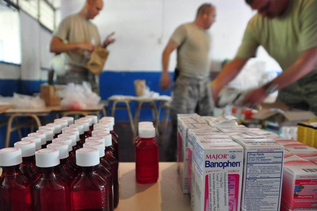Pharmacy personnel prepare medicine Nov. 20 in San Diego, El Salvador. JTF-Bravo Medical Element performed a Medical Civil Action Program, or MEDCAP, from Nov. 19 to 23 treating 2,987 people in several different cities affected by the El Salvador mudslides.