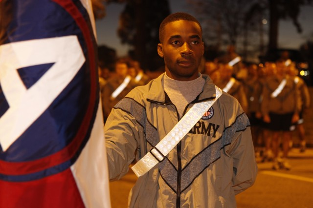 FORT MCPHERSON, Ga. ( Nov. 6, 2009) - Staff Sgt. Christopher Bolden, Third Army/U.S. Army Central Digital Army Liaison Team assistant operations noncommissioned officer, holds the Third Army colors prior to a motivational run celebrating Third Army's 91st  birthday at Fort McPherson, Ga. Nov. 6. Bolden was awarded the Soldiers medal Dec. 7 for his actions in saving a woman that was ejected from her car when it veered off the highway.