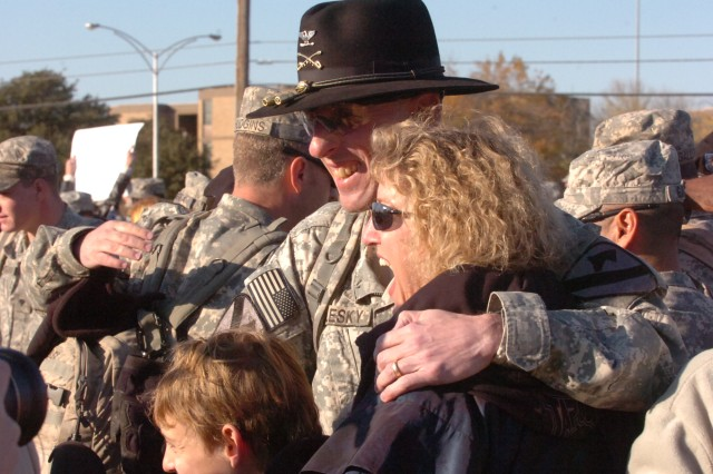 Col. Gary Volesky, commander of 3rd Heavy Brigade Combat Team, 1st Cavalry Division, rejoices with wife Lee Ann and his 11-year-old son, Alex, during 3rd HBCT's homecoming at Cooper Field at the division headquarters, Dec. 3, at Fort Hood, Texas. The brigade completed a 12-month deployment in northern Iraq, where they successfully withdrew from the inter-city of Mosul.