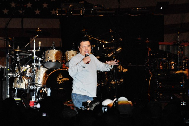 "Comedian Carlos Mencia entertains servicemembers at Forward Operating Base Warrior, Kirkuk, Iraq, Dec. 2. Mencia, along with singers Kid Rock and Jessie James are performing throughout Southwest Asia and Europe as part of an U.S. Air Force Reserve sponsored tour dubbed ""Tour for the Troops 2009."""