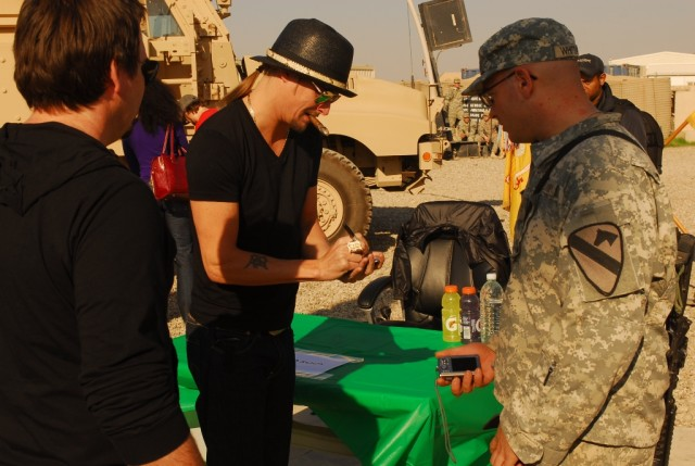 Pfc. Benjamin Whittaker, a Boise, Idaho, native and an infantryman with 1st Battalion, 8th Cavalry Regiment, 2nd Brigade Combat Team, 1st Cavalry Division, gets singer Kid Rock's signature during a visit to Joint Security Station McHenry in Kirkuk pr...