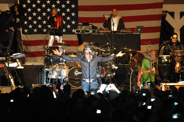 "Singer Kid Rock performs ""Rock and Roll Jesus"" during a concert at Forward Operating Base Warrior, Kirkuk, Iraq, Dec. 2. Rock, along with comedian Carlos Mencia and singer Jessie James are performing throughout Southwest Asia and Europe as part of an U.S. Air Force Reserve sponsored tour dubbed ""Tour for the Troops 2009."""
