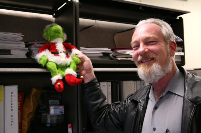 Mike Mitchell, U.S. Army Space and Missile Defense Command/Army Forces Strategic Command Huntsville Force Protection officer, shows off his office deocrations - a dancing Grinch.