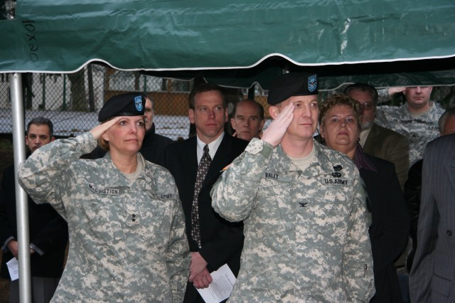 Maj. Gen. Patricia McQuistion, commander of the 21st TSC, and Col. Jack Haley, commander of the 405th AFSB, salute during the playing of the national anthem during the brigade's unfurling of the colors ceremony at its new home in Kaiserslautern, Germany.