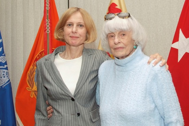 Linda Camp, head of the Garrison Equal Emploument Oportunity Office, announced that she would retire early next year. She also gave thanks to her 91-year-old mother, pictured with her, who has supported Camp throughout her career.