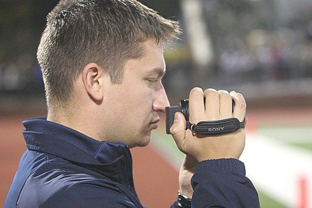 "Navy Midshipman Granger Benson, a videographer for the Navy Sprint football team, videotaped the Army-Navy Sprint football game in October. Granger and his brother, Everett, will both be in Philadelphia, Pa., rooting on their schools this Saturday for the 110th playing of the Army-Navy football game. Granger is confident that Navy will continue its dominance over Army, while Everett thinks ""Army can win this one."""