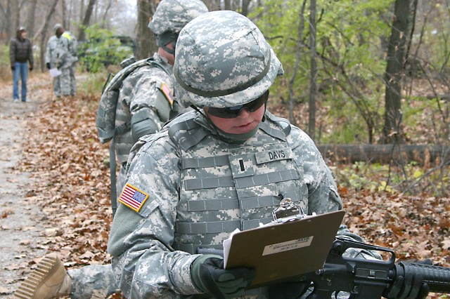 "1st Lt. Heather Davis of the Army Sustainment Command-Army Reserve Element conducts the task ""Perform voice communications SITREP/SPOTREP"" during a patrol as part of the Situation Training Exercise (STX) Lanes Training Nov. 15 at Rock Island Arsenal. The STX lane training focused on Warrior Tasks and Battle Drills to hone the Soldiers' skills and confidence to effectively function, survive and win in a combat environment. All 30 Soldiers who participated are slated for deployment to Southwest Asia."