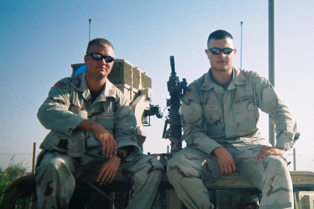 Senior Matt Coulthard (right), then a private first class with the 4th Infantry Division, sits atop a vehicle with his platoon leader, 1st Lt. JJ Simonsen, in Iraq during his yearlong deployment during Operation Iraqi Freedom I. Coulthard said Simonsen, a 2001 West Point grad, played an important role in getting him to West Point.  Coulthard will suit up for his first Army-Navy football game Saturday in Philadelphia.            PHOTOS PROVIDED