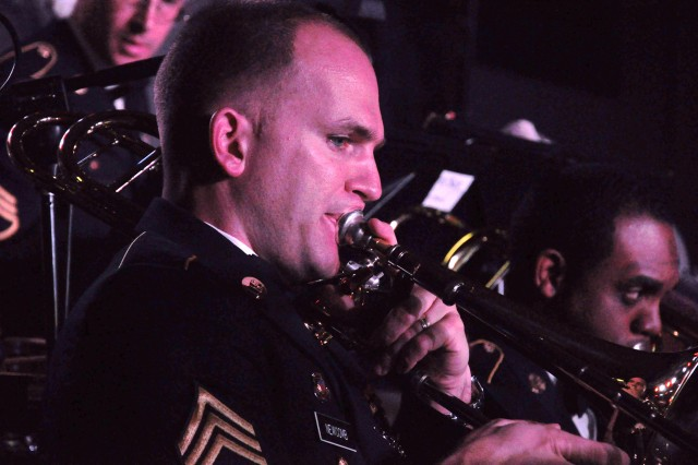 Staff Sgt. David Newcomb, a member of the 282nd Army Band, plays his trombone during a performance Sunday at the Solomon Center. The band performed its annual Christmas concert.