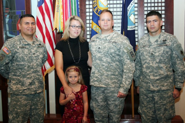 (Left to right) Staff Sgt. Geczel Rivera, Pamela and Zoe Cockrell, Staff Sgt. Jeffrey Cockrell and Staff Sgt. Mauricio Sosa attend a recognition ceremony.