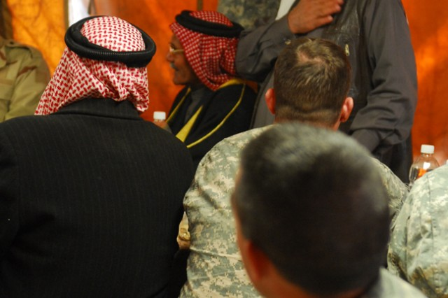 Lieutenant Colonel David Lesperance, the commander of 1st Battalion, 8th Cavalry Regiment, 2nd Brigade Combat Team, 1st Cavalry Division, introduces the leaders of the Sons of Iraq on Dec. 4th at Joint Security Station McHenry in Kirkuk province, Iraq.