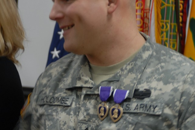Staff Sgt. Kirk Holcome, wearing his double Purple Hearts, greeted well-wishers after the awards ceremony