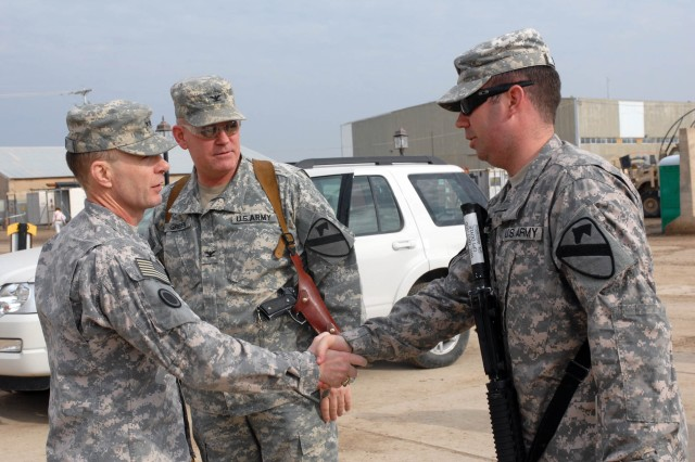 """CAMP TAJI, Iraq- Lt. Gen. Charles Jacoby (left), commander of Multi-National Corps Iraq, and Col. Tobin Green (center), commander of the 1st Brigade Combat Team, 1st Cavalry Division, meet with Capt. Michael Doyle, from San Diego, during a visit to Camp Taji, Dec. 5.  Jacoby visited the """"Ironhorse"""" Bde. to discuss current operations and preparations for the future drawdown of U.S. Forces in Iraq."""