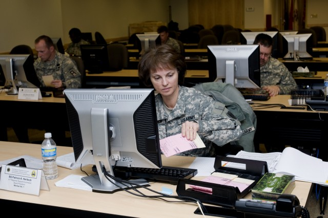 Brig. Gen. Pat Heritsch, the commanding general of the 100th Training Division and selection board president, reviews a candidate's packet during the lieutenant colonel command selection board held Dec. 6 - 9 at the 81st Regional Support Command at Fort Jackson, S.C.