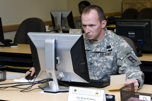 Col. Steven Merkel, who is assigned to First Army, Division East, reviews a candidate's packet during a recent lieutenant colonel command selection board held Dec. 6 - 9 at the 81st Regional Support Command at Fort Jackson, S.C.