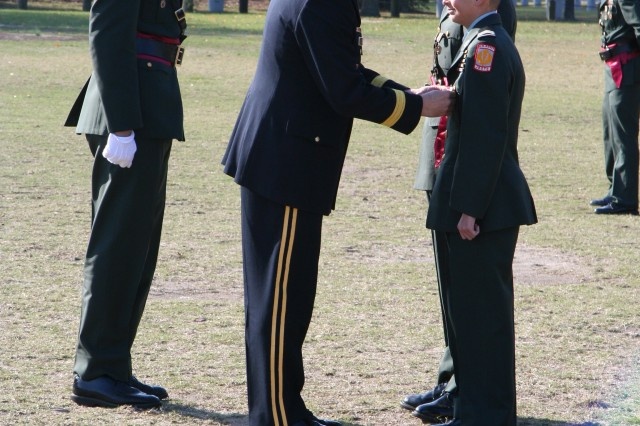 The school's God and Country Medal was presented to Cadet Capt. Anthony L. DeVanea (rear), and the George K. Gannam Medal to Cadet Staff Sgt. James C. Reintzell (front) by Brig. Gen. Phillips.