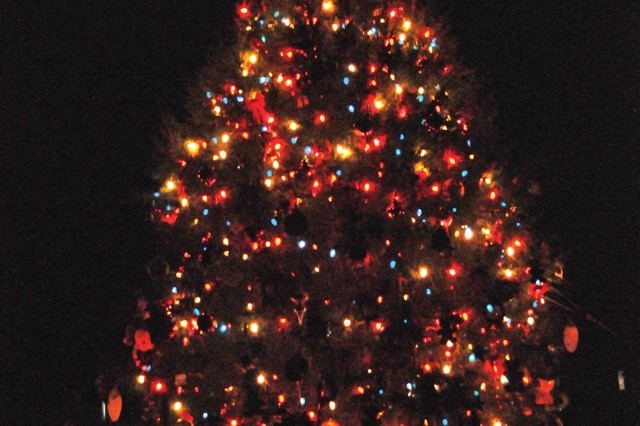A towering Christmas tree sheds light on Howze Parade Field after the Dec. 3 tree lighting ceremony.