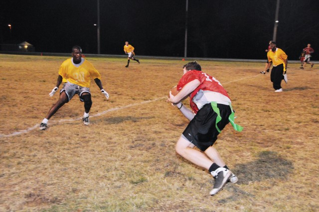 Thundercats wide receiver Scott Rosenshein looks for space to run to after catching a pass during the intramural football game's fourth quarter. Rosenshein had a touchdown reception in a 21-6 playoff victory over the 6th MP Detachment Bulldogs Monday at the Fort Rucker Physical Fitness Facility.