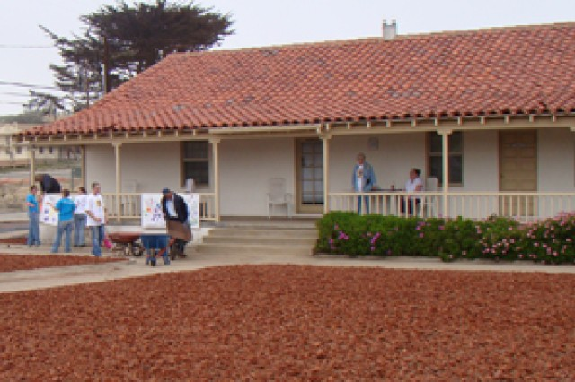 "PRESIDIO OF MONTEREY, Calif. Aca,!"" Local volunteers assist in beautifying the Veterans Transition Center of Monterey County during Make A Difference Day Oct. 24."