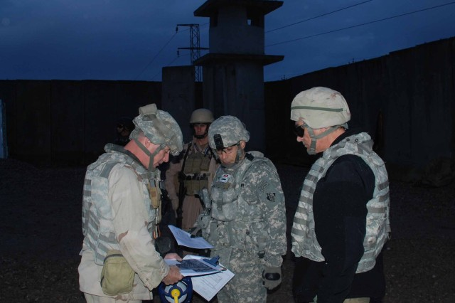 USACE Gulf Region District Commander Col. Dan Anninos, center, inspects the progress of an expedient police station in Mosul with Navy Lt. Cmdr. Frank Carroll, left, project engineer of the police station construction, and Larry Petrosino, the GRD deputy of program management.