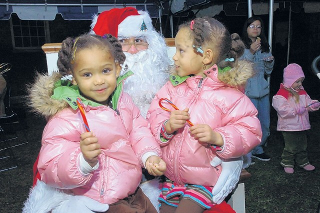 FORT BELVOIR, Va. -- Jada, 3, and Jasmine, 4, Washington visited with Santa during the Holiday Tree lighting ceremony Firday.