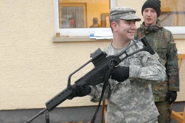 Private First Class Gary Pritt, a chaplain's assistant with Headquarters and Headquarters Company, 18th Military Police Brigade, gets a feel for the German G36 rifle during a Preventive Maintenance Inspection with German Feldjagers (military police) prior to firing at Feldjager Battalion 251's Schützenschnur range Dec. 3 in Mainz, Germany. The MP Soldiers were invited to earn their Schützenschnur badges through the 18th MP Brigade's partnership with their German counterparts.