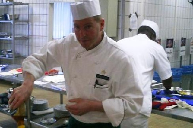 Sgt. Joseph Dinuzzo, a food service specialist with Forward Support Company, 54th Engineer Battalion, 18th Engineer Brigade, 21st Theater Sustainment Command, prepares a meal during the U.S. Army Europe Culinary Arts Competition held in Grafenwoehr Nov 19. Dinuzzo won a silver medal in the senior chef of the year category.