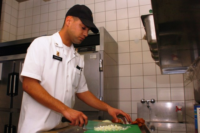 Pfc. Matthew Hendricks, a food service specialist with the 28th Transportation Battalion, 18th Military Police Brigade, 21st Theater Sustainment Command, practices his knife skills in preparation for the 34th Annual Culinary Arts Competition. Hendricks is the USAREUR junior chef of the year and will be competing in five different events at the competition in Virginia in March.