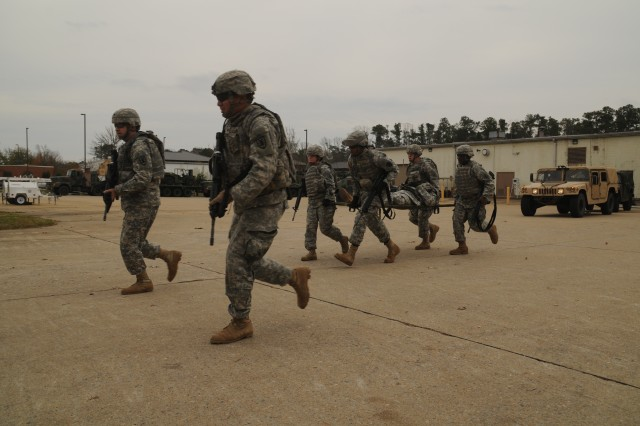 """""""Airborne D"""" Soldiers of the 567th Inland Cargo Transfer Company conduct tactical movement during training in preparation for an upcoming deployment to Afghanistan.  The unit training was covered by Norfolk's WVEC news as part of their """"A Holiday Salute"""" to troops program.  (US Army photo by Sgt First Class Kelly Jo Bridgwater)"""