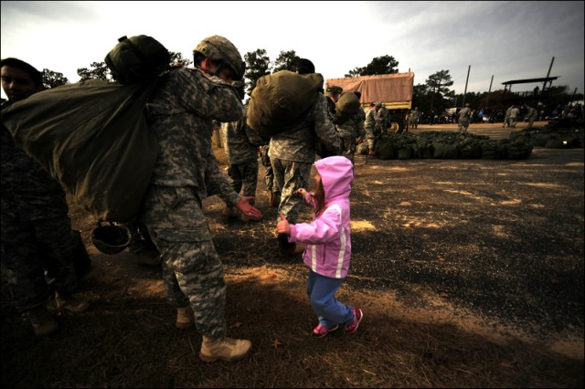 A girl runs to her father after he performed a static line jump out of an C-130 Hercules during the 12th Annual Operation Toy Drop, on Fort Bragg, N.C., Dec. 6, 2009.Operation Toy Drop is an annual Airborne jump held at Fort Bragg, N.C., and is hosted by the U.S. Army Civil Affairs and Psychological Operations Command (Airborne), and supported by Fort Bragg's XVIII Airborne Corps and Pope Air Force Base's 43rd Airlift Wing. Over 3,000 Soldiers are expected to donate a toy for a lottery ticket and the chance to jump under an international jumpmaster in order to earn their foreign jump wings. The operation gives Soldiers and Airmen the opportunity to help local families in need over the holidays while boosting moral and incorporating valuable training. Since its inception, Operation toy Drop has collected and distributed more than 30,000 toys for families of Soldiers as well Orphanages in the local community.