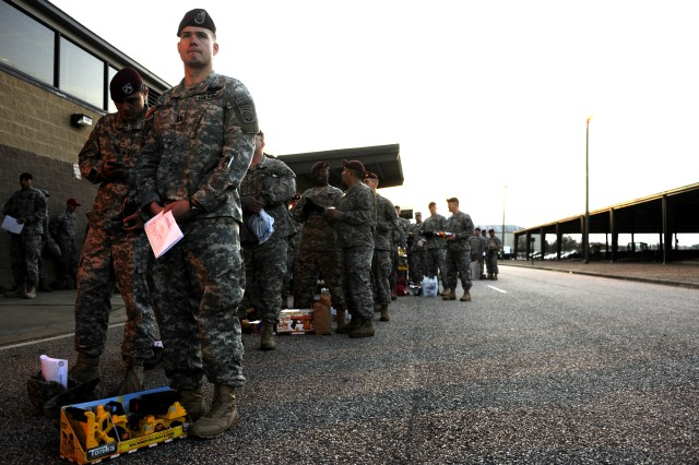 U.S. Army Soldiers wait with their toys before the start of Operation Toy Drop Dec. 4 at Pope Air Force Base, N.C.  Operation Toy Drop is an annual Airborne jump held at Fort Bragg, N.C. hosted by the U.S. Army Civil Affairs & Psychological Operations Command (Airborne), and supported by Fort Bragg's XVIII Airborne Corps and Pope Air Force Base's 43rd Airlift Wing.  Over 3,000 Soldiers are expected to donate a toy for a lottery ticket and the chance to jump under an international jumpmaster in order to earn their foreign jump wings.  The operation gives Soldiers and Airmen the opportunity to help local families in need over the holidays while boosting morale and incorporating valuable training.