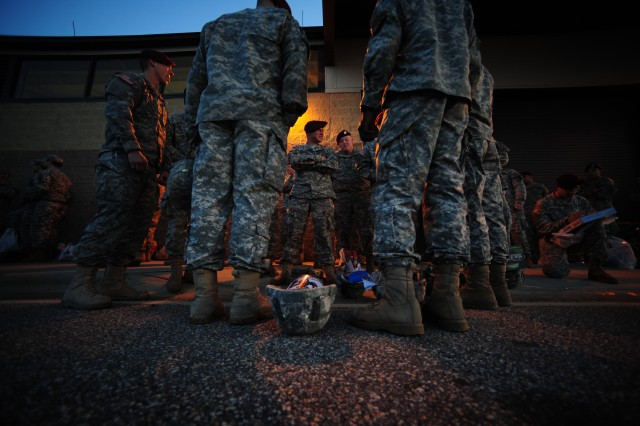 Soldiers from the 82nd Airborne Division, 1-73 Cavalry Regiment, wait in line with their toys early in the morning to ensure their chances of receiving a lottery ticket during this year's Operation Toy Drop Dec. 4 on Pope Air Force Base.  Operation Toy Drop is an annual Airborne jump held at Fort Bragg, N.C. hosted by the U.S. Army Civil Affairs & Psychological Operations Command (Airborne), and supported by Fort Bragg's XVIII Airborne Corps and Pope Air Force Base's 43rd Airlift Wing.  Over 3,000 Soldiers are expected to donate a toy for a lottery ticket and the chance to jump under an international jumpmaster in order to earn their foreign jump wings.  The operation gives Soldiers and Airmen the opportunity to help local families in need over the holidays while boosting morale and incorporating valuable training.
