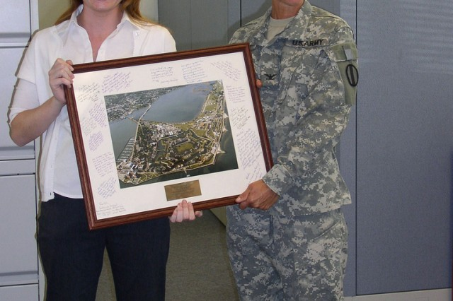 Example of an entry.  COL Jody Draves, TRADOC PAO, presents Kristin signed Fort Monroe photo upon completion of her intern training.