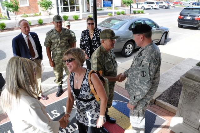 Example of an entry.  General Martin Dempsey, Commanding General of the US Army Training and Doctrine Command, and his wife Deanie welcome General and Mrs. Erdal Ceylanogluto, Republic of Turkey Land Forces Training and Doctrine Command, to TRADOC headquarters. Photo by PFC Andrew Mckee, US Army