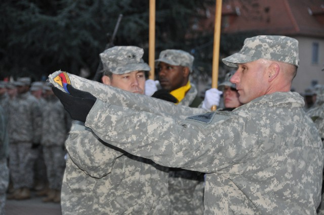 Maj. Gen. Terry Wolff, 1st Armored Division commanding general, and Command Sgt. Maj. William Johnson, case the 1st Armored Division Special Troops Battalions colors.