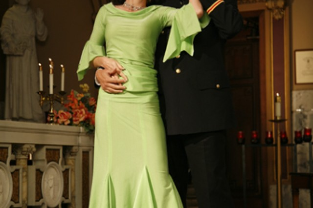 """Olivia"" (Margaret Lambos) dances with the ghost of her ""husband,"" actor Mark Nillson, in the award winning movie short ""Last Dance.""  Lambos is the wife of HHB, 100th MDB (GMD) commander, Capt. George Lambos.  She both starred in and 	 choreographed the dancing for the movie which won the Audience Choice Award in the 2008 Chicago International Reel Shorts Festival. Photo by Dorota Szalkowski, reprinted with permission of Aleksandra Hodowany"