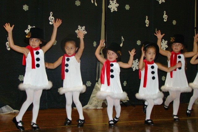 ALIAMANU MILITARY RESERVATION, Hawaii -- SKIES program dancers show off their holiday form during the annual Aliamanu Military Reservation Holiday Funfest, Dec. 5. The event featured 18 dance performances by children as young as two years old.