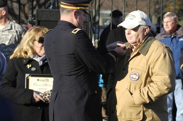 """Col. David Griffith, director of Freedom Team Salute, pins a commendation on Morrill Worcester, owner of the Worcester Wreath Company, for his efforts over the past 18 years in donating thousands of wreaths across the country to honor fallen servicemembers during the holiday season."""""""