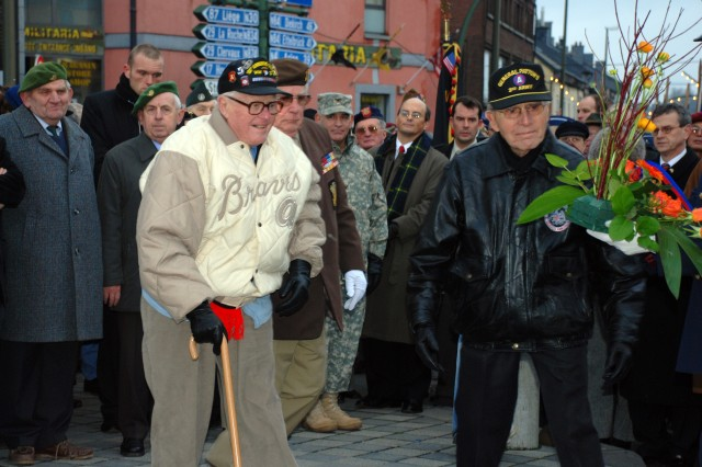 "World War II veterans Everett Aca,!A""RedAca,!A? Andrews and Maurice Sperandieu lay a wreath at the base of Gen. Anthony McAuliffeAca,!a,,cs monument in Bastogne, Belgium, Dec. 19, 2009, as part of the 65th anniversary of the Battle of the Bulge."