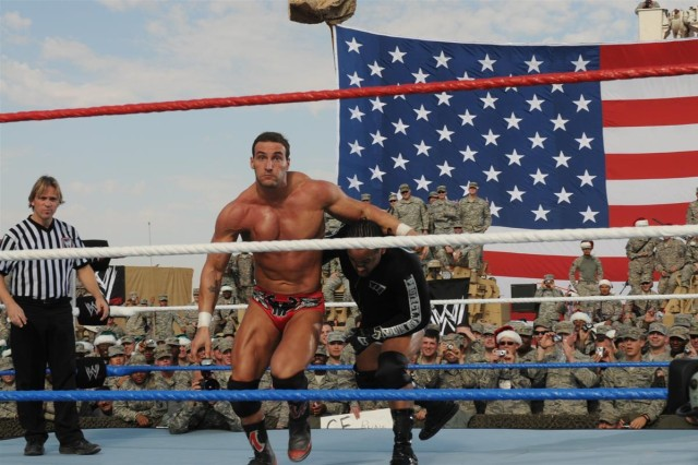 """World Wrestling Entertainment superstars Chris Masters and MVP perform for the troops Dec. 4 at Holt Stadium at Joint Base Balad, Iraq. WWE superstars and divas came to Iraq to film and perform the """"WWE Tribute to the Troops,"""" which will air Dec. 19 at 9 p.m. Eastern time."""