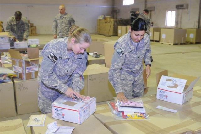 First Lt. Danielle Pappas, an intelligence officer with the 541st Combat Sustainment Support Battalion, 96th Sustainment Brigade, 13th Sustainment Command (Expeditionary) and a Fox Lake, Ill., native, and Spc. Cheryl Salaiz, a light wheel vehicle mechanic with the 623rd Quartermaster Company, 541st CSSB and a Las Cruces, N.M., native, pack school supplies Dec. 4 to make kits for schoolchildren near Contingency Operation Location Taji, Iraq. The kits will passed out to Iraqi schoolchildren during humanitarian missions conducted by volunteers with Operation Back to School