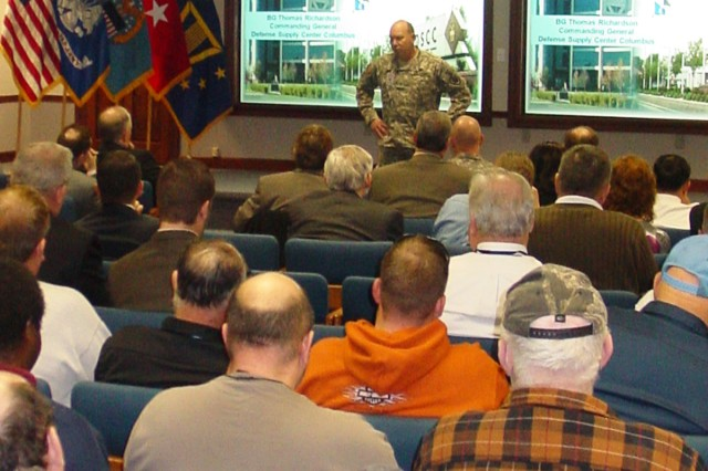 DSCC Commanding General Army Brig. Gen. Thomas Richardson briefs Tobyhanna Army Depot employees on the DSCC mission, vision and values during a Dec. 2 town hall meeting. (DSCC photos by John Foreman)