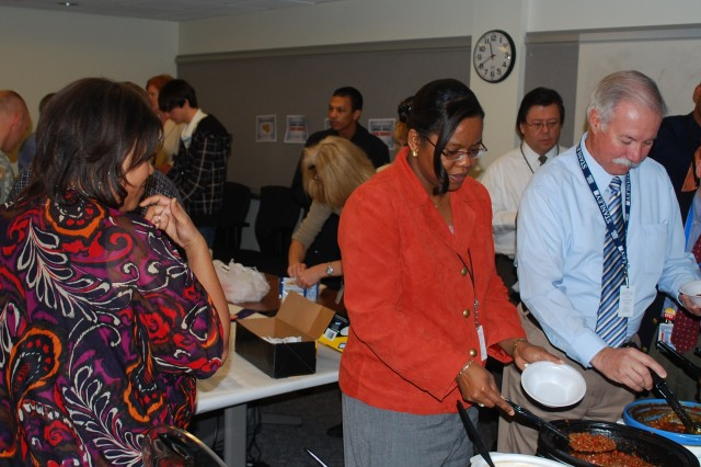 Almost a dozen Army Contracting Command  and Expeditionary Contracting Command employees prepared their finest chili recipes in hopes of being names the command' chili champion.