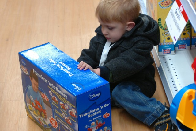 Fort Bragg Military children help pick out gifts for others through Toys for Tots program