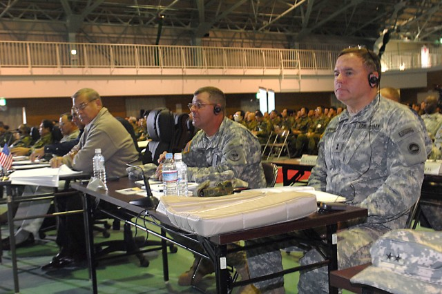 CAMP HIGASHI-CHITOSE, Japan- (From right) Maj. Gen. Walter Wiercinski, commanding general I Corps Japan and Command Sgt. Maj. Joseph P. Zettlemoyer, U.S. Army, Pacific command sergeant major, watch a presentation during the Exercise Yama Sakura 57 After Action Review, the final closing portion of the exercise.  Yama Sakura is an annual bilateral command post exercise between the Japan Ground Self Defense Force and the U.S. Army. (photo by Staff Sgt. Crista Yazzie, USARPAC Public Affairs)