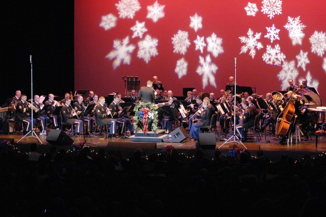 """The U.S. Army Ground Forces Band entertains the crowd with its rendition of Irving Berlin's classic """"White Christmas"""" during its 24th annual Holiday Concert Dec. 11 at the Cobb Energy Performing Arts Center in Atlanta. U.S. Army photo by Jessica Maxwell, FORSCOM Public Affairs"""