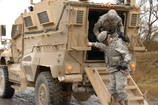 Soldiers from the 16th Sustainment Brigade dismount from a Mine Resistant Ambush Protected vehicle during training. The 16th Sust. Bde. trained with the MRAP vehicles Dec. 7-8 in Grafenwoehr.